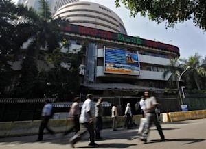 People walk past the Bombay Stock Exchange (BSE) building in Mumbai February 6, 2014. REUTERS/Mansi Thapliyal/Files
