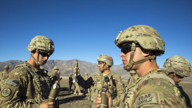 U.S. soldiers in Dragon Company of the 3rd Cavalry Regiment take part in a mortar exercise near forward operating base Gamberi in the Laghman province of Afghanistan