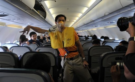 A cabin crew member of budget Philippine airline Cebu Pacific performs a dance as part of the inflight safety demonstration, on October 8, 2010. A group of medical specialists has provided an answer to a dilemma that has faced flyers since the Wright brothers took to the air in 1903 -- is it okay to fart mid-flight?