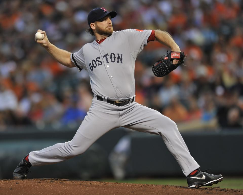 Boston Red Sox pitcher Ryan Dempster delivers against the Baltimore Orioles in the first inning of a baseball game on Saturday, July 27, 2013, in Baltimore. (AP Photo/Gail Burton)
