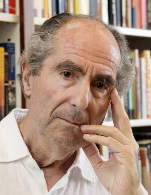 """FILE - In this Sept. 8, 2008 file photo, author Philip Roth poses in the offices of his publisher Houghton Mifflin, in New York. Roth, the American author of the 1960s cultural touchstone """"Portnoy's Complaint"""" and more than two dozen other novels, was named Wednesday, May 18, 2011, as the winner of the Man Booker International Prize for fiction. The prize is awarded every two years to a living writer for overall contribution to fiction. (AP Photo/Richard Drew, File)"""
