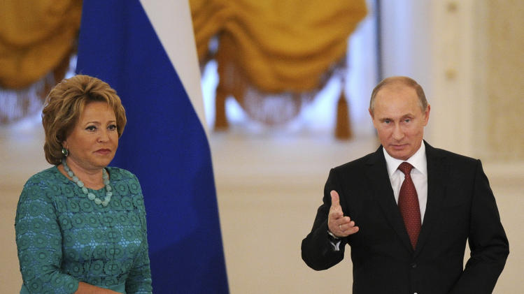 Russian President Vladimir Putin, left, and the speaker of Russia's senate Valentina Matviyenko