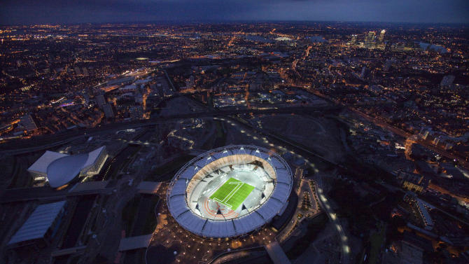"""FILE - In this undated file photo made available on July 25, 2011 by the London Organising Committee of the Olympic and Paralympic Games (LOCOG), an aerial photo of the London 2012 Olympic Stadium to mark """"1 year to go to the Olympic Games"""" is seen in London. People on low incomes who live near the Olympic stadium in London may have to move to other parts of the country, the mayor of the local borough said Tuesday, April 24, 2012. (AP Photo/LOCOG, Anthony Charlton, File)"""