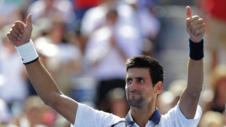 Novak Djokovic of Serbia celebrates winning his match against Brazil's Rogerio Dutra Silva  in the third round of play at the 2012 US Open tennis tournament,  Friday, Aug. 31, 2012, in New York. (AP Photo/Mike Groll)