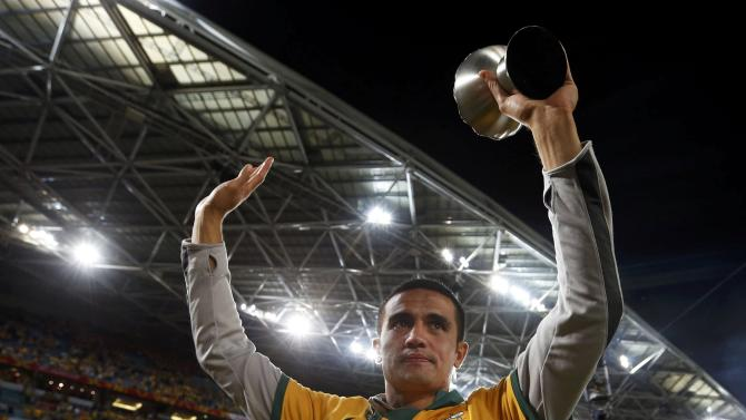 Australia's Tim Cahill poses with his medal after they beat South Korea to win the Asian Cup at the Stadium Australia in Sydney
