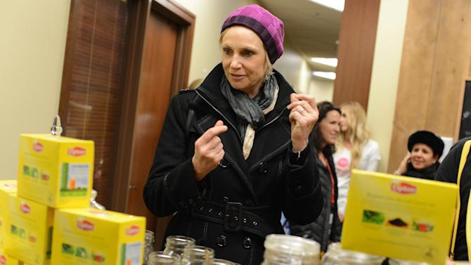"IMAGE DISTRIBUTED FOR LIPTON: Actress Jane Lynch snaps into action customizing her own tea blend, which she dubbed ""Kick of Spice"" at the Lipton Uplift Lounge Tea Bar during Sundance on Sunday Jan. 20, 2013, in Park City, UT.(Photo by Jordan Strauss/Invision for Lipton/AP Images)"