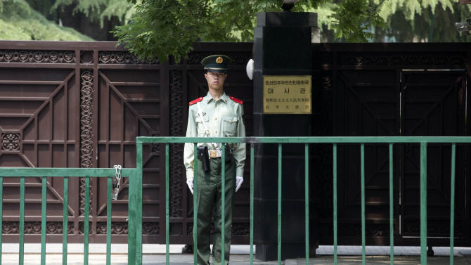 A Chinese paramilitary policeman stands guard outside the North Korean embassy in Beijing, China, Wednesday, May 22, 2013. North Korean leader Kim Jong Un dispatched a high-profile official and close confidant to travel to China on Wednesday as a special envoy while Beijing is under pressure to rein in its belligerent neighbor.  (AP Photo/Ng Han Guan)