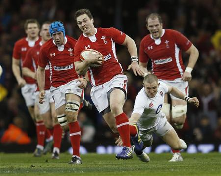 Wales' North is tackled by England's Brown during their Six Nations international rugby union match at the Millennium Stadium in Cardiff