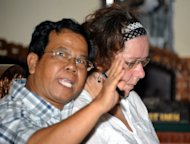 Briton Lindsay June Sandiford (R) with her interpreter during her trial at a court in Denpasar on the Indonesian resort island of Bali on December 20, 2012. Indonesian prosecutors recommended a 15-year prison term Thursday for Sandiford, a British grandmother accused of trafficking in cocaine on the resort island of Bali