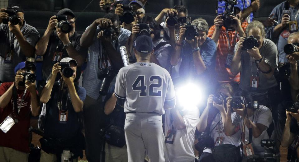 American League's Mariano Rivera, of the New York Yankees, poses for photographers after the MLB All-Star baseball game, on Tuesday, July 16, 2013, in New York. Rivera was named the game's MVP. (AP Photo/Frank Franklin II)