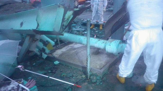 FILE - In this Wednesday, May 11, 2011 photo released by Tokyo Electric Power Co. (TEPCO), workers look at a pit, center, which is being filled with concrete after they found another leak of radioactive water into the sea, near a seawater intake of the No. 3 reactor building at the tsunami-crippled Fukushima Dai-ichi nuclear power plant in Okuma town, Fukushima Prefecture, northeastern Japan. The operator of a Japanese nuclear plant that went into a tsunami-triggered meltdown knew the risks from highly radioactive water at the site but sent in crews without adequate protection or warnings, a worker said in a legal complaint filed Tuesday, Oct. 31, 2012. Asked about the allegations, a TEPCO spokesman said the plant was aware of water leaks elsewhere but couldn't anticipate the water problem in Unit 3's basement. (AP Photo/Tokyo Electric Power Co., File) EDITORIAL USE ONLY
