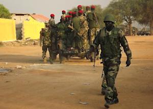 A group of South Sudanese soldiers patrol the streets …