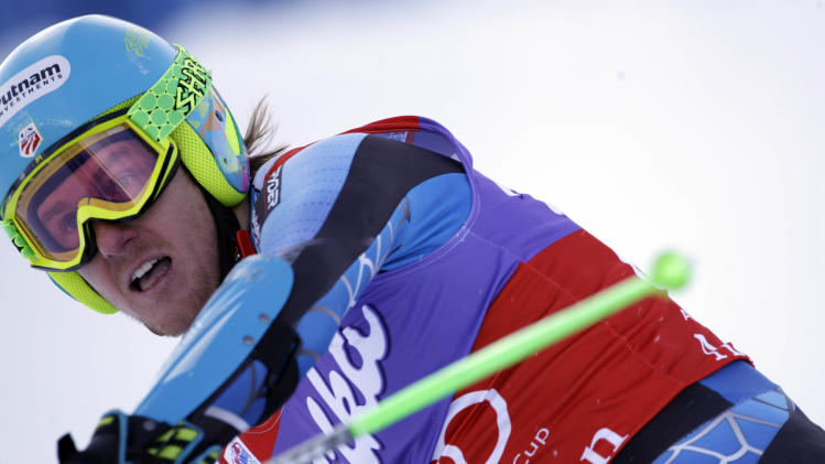 Ted Ligety of the Unites States reacts after winning an alpine ski, men's World Cup giant slalom in Adelboden, Switzerland, Saturday, Jan.12, 2013. (AP Photo/Alessandro Trovati)