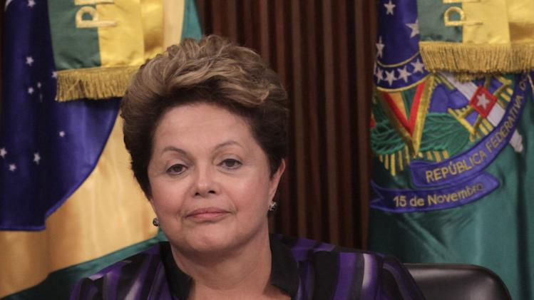 Brazil's President Dilma Rousseff meets with governors and mayors representing Brazil's 26 states and its federal district, to discuss the wave of protests, at the Presidential Palace, in Brasilia, Brazil, Monday, June 24, 2013. The recent protests have become the largest public demonstrations Latin America's biggest nation has seen in two decades. They began as opposition to transportation fare hikes, then became a laundry list of causes including anger at high taxes, poor services and World Cup spending, before coalescing around the issue of rampant government corruption. (AP Photo/Eraldo Peres)