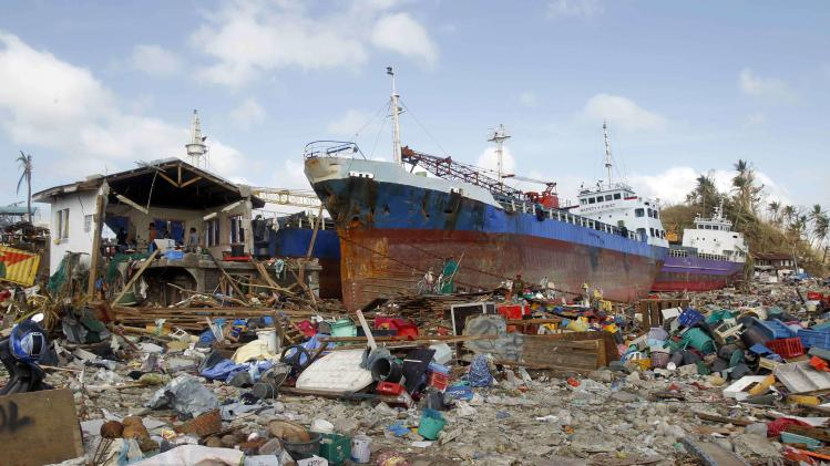 Cargo ships washed ashore are seen after super typhoon Haiyan hit Anibong town, Tacloban