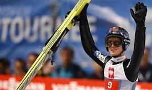 Austria's Morgenstern reacts after taking the second place in the overall ranking of the four-hills ski jumping tournament after the final jumping in Bischofshofen