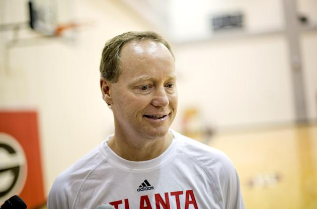 Atlanta Hawks head coach Mike Budenholzer talks to reporters following NBA basketball training camp, Tuesday, Oct. 1, 2013, in Athens, Ga
