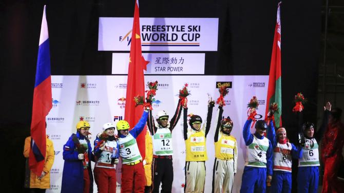 The Russian, Chinese, and Belarus teams stand on the podium after winning the FIS Freestyle Ski World Cup team aerials in Beijing