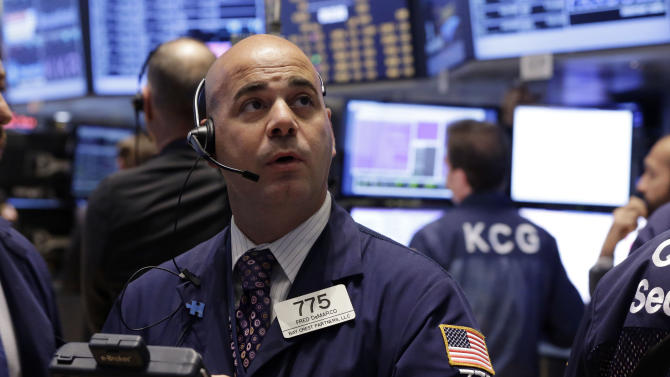 Trader Fred DeMarco works on the floor of the New York Stock Exchange Wednesday, Sept. 18, 2013.  Stocks were little changed in early trading Wednesday as investors wait to hear from the Federal Reserve on the fate of the central bank's bond-buying program. (AP Photo/Richard Drew)