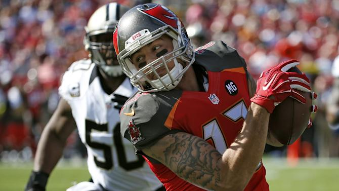 Tampa Bay Buccaneers wide receiver Mike Evans (13) turns up field away from New Orleans Saints middle linebacker Curtis Lofton (50) after a reception in the first quarter of an NFL football game, Sunday, Dec. 28, 2014, in Tampa, Fla. (AP Photo/Brian Blanco)