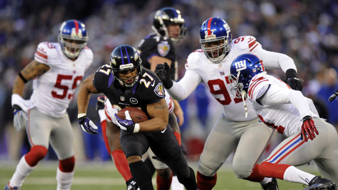Baltimore Ravens running back Ray Rice (27) attempts to rush past New York Giants defenders in the first half of an NFL football game in Baltimore, Sunday, Dec. 23, 2012. (AP Photo/Nick Wass)