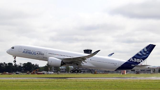 The Airbus A350 takes off successfully on its maiden flight at Blagnac airport near Toulouse, southwestern France, Friday, June 14, 2013.The Airbus A350 has taken off on its first flight, setting up major competition for Boeing after the U.S. aerospace company ran into problems with the lithium batteries of its 787 Dreamliner. Friday's flight from Toulouse is to last about four hours and marks a key step on the path to full certification. Airbus is promoting the plane as a fuel-saver at a time when jet fuel prices represent about half the cost of long-haul flights. (AP Photo/Bob Edme)