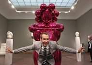 "US artist Jeff Koons poses for a photo in front of his sculpture ""Balloon Venus"" at the Liebighaus Skulpturen Sammlung in the central German city of Frankfurt am Main"