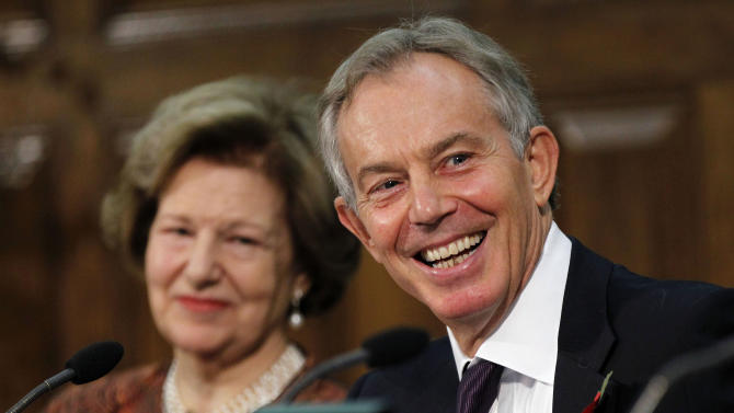 Former British Prime Minister Tony Blair, right, reacts to a media question after his speech to the delegates, at the Iraq Britain Business Council (IBBC) fourth annual conference in central London, Monday, Nov. 5, 2012. Baroness Nicholson, IBCC Executive Chairman is in the background. Former Prime Minister Tony Blair says British forces should be proud of their role in the U.S.-led invasion of Iraq, citing what he claimed is major progress made in the country since the toppling of Saddam Hussein in 2003.  (AP Photo/Sang Tan, Pool)