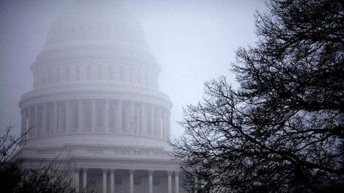 FILE - In this Monday, Dec. 10, 2012, file  photo, fog obscures the Capitol dome on Capitol Hill in Washington. Even if Congress and the White House fail to strike a budget deal by New Year's Day, reality may be a lot less bleak then the scenario that's been spooking employers and investors and slowing the U.S. Economy. The tax increases and spending cuts could be retroactively repealed after Jan. (AP Photo/J. Scott Applewhite, File)