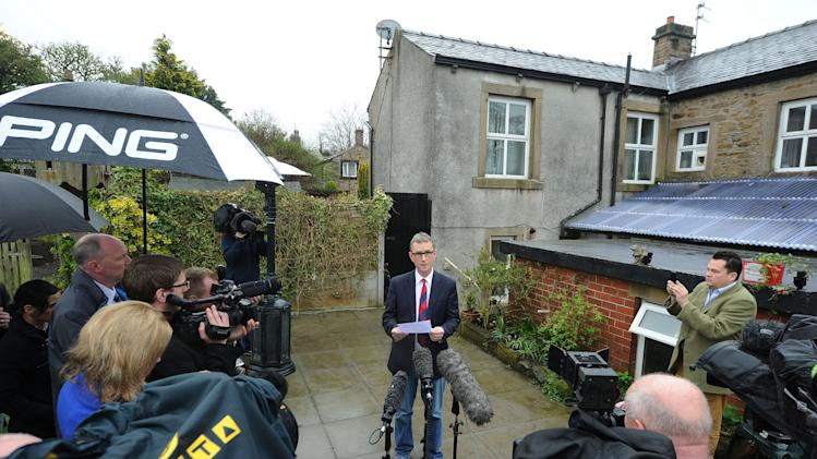"Britain's Deputy House speaker Nigel Evans gives a press statement at his home in Pendleton, north west England, where he said Sunday May 5, 2013, that allegations him for rape and sexual assault are ""completely false.""  Evans, 55, was arrested on Saturday. He was questioned about sex offenses that allegedly took place between July 2009 and March 2013 and was later released on bail. Evans — who has served in Parliament for two decades — says the allegations were made by ""two people well known to each other"" and who until recently he had regarded as friends, even socializing with one accuser last week. (AP Photo/PA, Owen Humphreys)  UNITED KINGDOM OUT  NO SALES  NO ARCHIVE"
