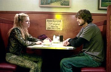 Amy Smart and Ashton Kutcher in New Line's The Butterfly Effect