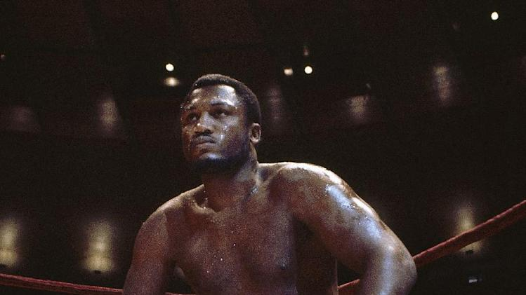 FILE - In this undated photo, boxer Joe Frazier is seated in the corner of the ring. The former heavyweight champion died after a brief fight with liver cancer. He was 67. The family issued a release confirming the boxer's death on Monday, Nov. 7, 2011. (AP Photo/File)