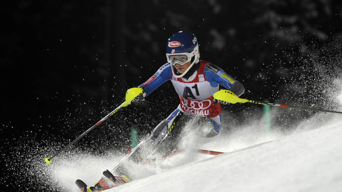 Mikaela Shiffrin, of the United States speeds past a pole on her way to clock the second fastest time in the first run of an alpine ski, women's World Cup slalom, in Flachau, Austria, Tuesday, Jan. 15, 2013. (AP Photo/Giovanni Auletta)