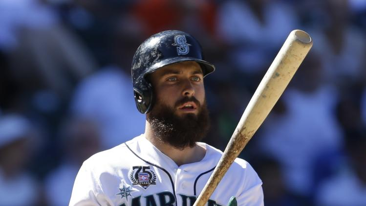 Seattle Mariners' Dustin Ackley tosses his bat during a baseball game against the Baltimore Orioles, Sunday, July 27, 2014, in Seattle. (AP Photo/Ted S. Warren)