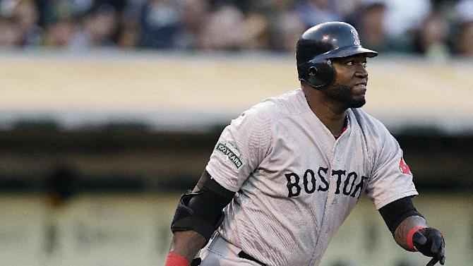 FILE - In this Juy 3, 2012, file photo, Boston Red Sox's David Ortiz runs to first base after hitting a single against the Oakland Athletics during a baseball game in Oakland, Calif. Ortiz and the New York Yankees' trio of Nick Swisher, Hiroki Kuroda and Rafael Soriano are among nine free agents who have received $13.3 million qualifying offers. Players have until Nov. 9 to accept the one-year contracts. If a player turns the offer down and signs elsewhere, his former team would receive an extra selection immediately following the end of the first round of next June's amateur draft. (AP Photo/Ben Margot, File)