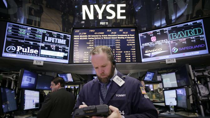 Stock trader Thomas Lyden works at the New York Stock Exchange, Monday, March 4, 2013 in New York. Uncertainty over the outcome of a budget battle in Washington pushed world stock markets lower on Monday. (AP Photo/Mark Lennihan)