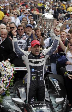 Tony Kanaan, of Brazil, celebrates after winning the Indianapolis 500 auto race at the Indianapolis Motor Speedway in Indianapolis, Sunday, May 26, 2013. (AP Photo/Darron Cummings)