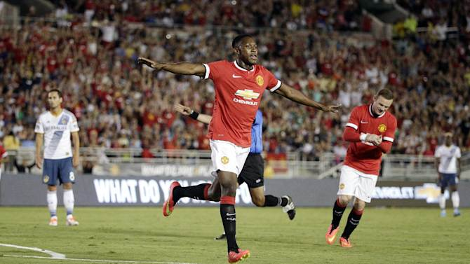 Manchester United's Danny Welbeck celebrates after scoring against the Los Angeles Galaxy during the first half of a friendly soccer match at Rose Bowl on Wednesday, July 23, 2014, in Pasadena, Calif. (AP Photo)