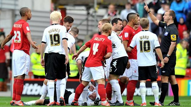 Nottingham Forest's Dexter Blackstock is sent off for a foul on Derby County's Richard Keogh