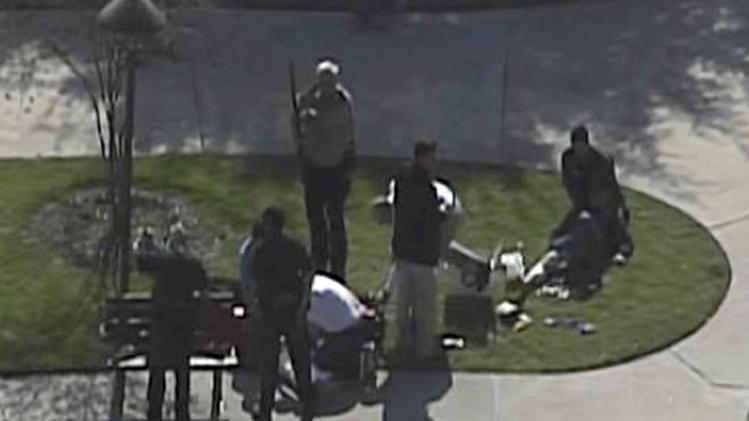 This frame grab provided by KPRC Houston shows the scene at Lone Star College Tuesday, Jan. 22, 2013 as police and emergency personnel work.  A shooting at the Texas community college campus wounded at least two people Tuesday and sent students fleeing for safety officials said.  (AP Photo/Courtesy KPRC TV)