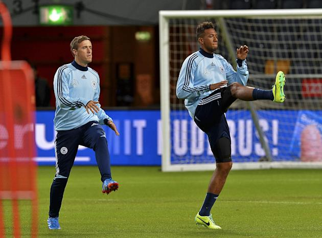 Germany's Max Kruse, left and Jerome Boateng, during training at Friends Arena in Stockholm, Sweden, Monday, Oct. 14, 2013. Germany will play Sweden in the Group C World Cup qualifier match on Tuesday