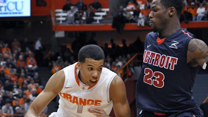 Syracuse's Michael Carter-Williams drives against Detroit's Doug Anderson during the first half of an NCAA college basketball game in Syracuse, N.Y., Monday, Dec. 17, 2012. (AP Photo/Kevin Rivoli)