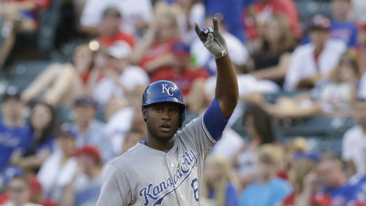 Kansas City Royals Lorenzo Cain (6) signals to the dugout during a baseball game against the Texas Rangers Friday, Aug. 22, 2014, in Arlington, Texas. (AP Photo/LM Otero)