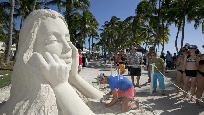 Susanne Ruseler puts finishing touches on her sand art entry at the International Sand Art Competition , in Key West, Florida