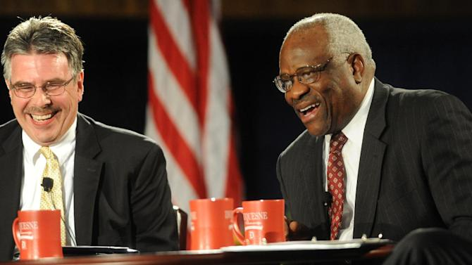"""Supreme Court Justice Clarence Thomas, right, and Dean Ken Gormley share a light moment during the Duquesne University School of Law presents, """"An Afternoon with Justice Clarence Thomas U.S. Supreme Court"""" in the Duquesne Union Ballroom on Tuesday April 9, 2013 in Pittsburgh.  (AP Photo/Tribune Review, Sidney Davis)  PITTSBURGH OUT  MANDATORY CREDIT"""