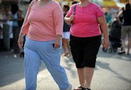 Photo illustration shows overweight women in the US. The drug Qsymia is approved for use in people who are obese, meaning they have a body mass index of 30 or higher, or in people who are overweight and have at least one related condition like diabetes, high cholesterol or high blood pressure