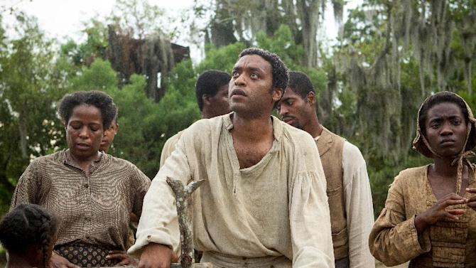 """This image released by Fox Searchlight shows Chiwetel Ejiofor, center, in a scene from """"12 Years A Slave."""" The Golden Globes nominations will be announced on Thursday, Dec. 12. Ejiofor was nominated for a Golden Globe for best actor in a motion picture drama for his role in the film on Thursday, Dec. 12, 2013. The 71st annual Golden Globes will air on Sunday, Jan. 12. (AP Photo/Fox Searchlight, Jaap Buitendijk)"""