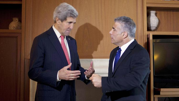 U.S. Secretary of State Kerry talks to Israel's Finance Minister Yair Lapid before their meeting in Jerusalem