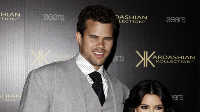 Kim Kardashian, right, and her fiance, NBA basketball player Kris Humphries, arrive at the Kardashian Kollection launch party in Los Angeles, Wednesday, Aug. 17, 2011. (AP Photo/Matt Sayles)