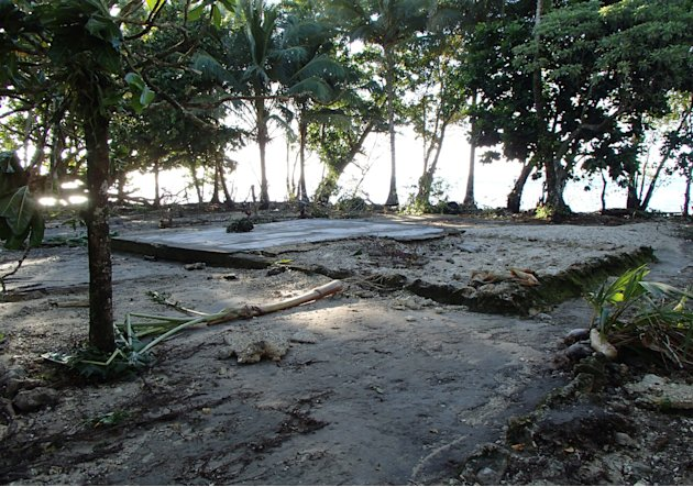 After the house was swept away by a Tsunami, the foundations mark the spot where a home used to be, seen Wednesday Feb. 6, 2013, following a Tsunami at Lata, Temotu province, Solomon Islands.  The dam